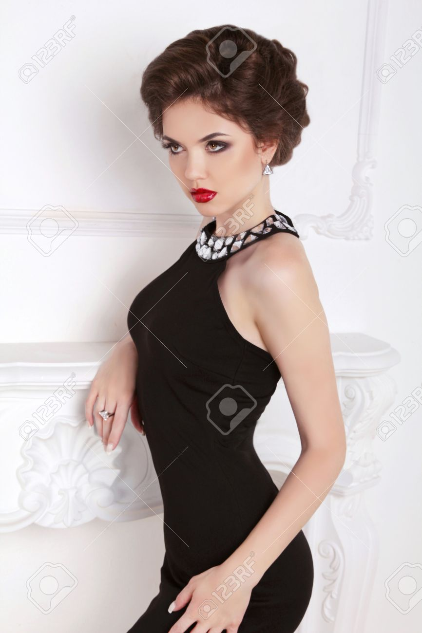 Black dress hairstyle - Fashion Beautiful Brunette Girl Model In Black Dress Posing Against The Wall Makeup Hairstyle