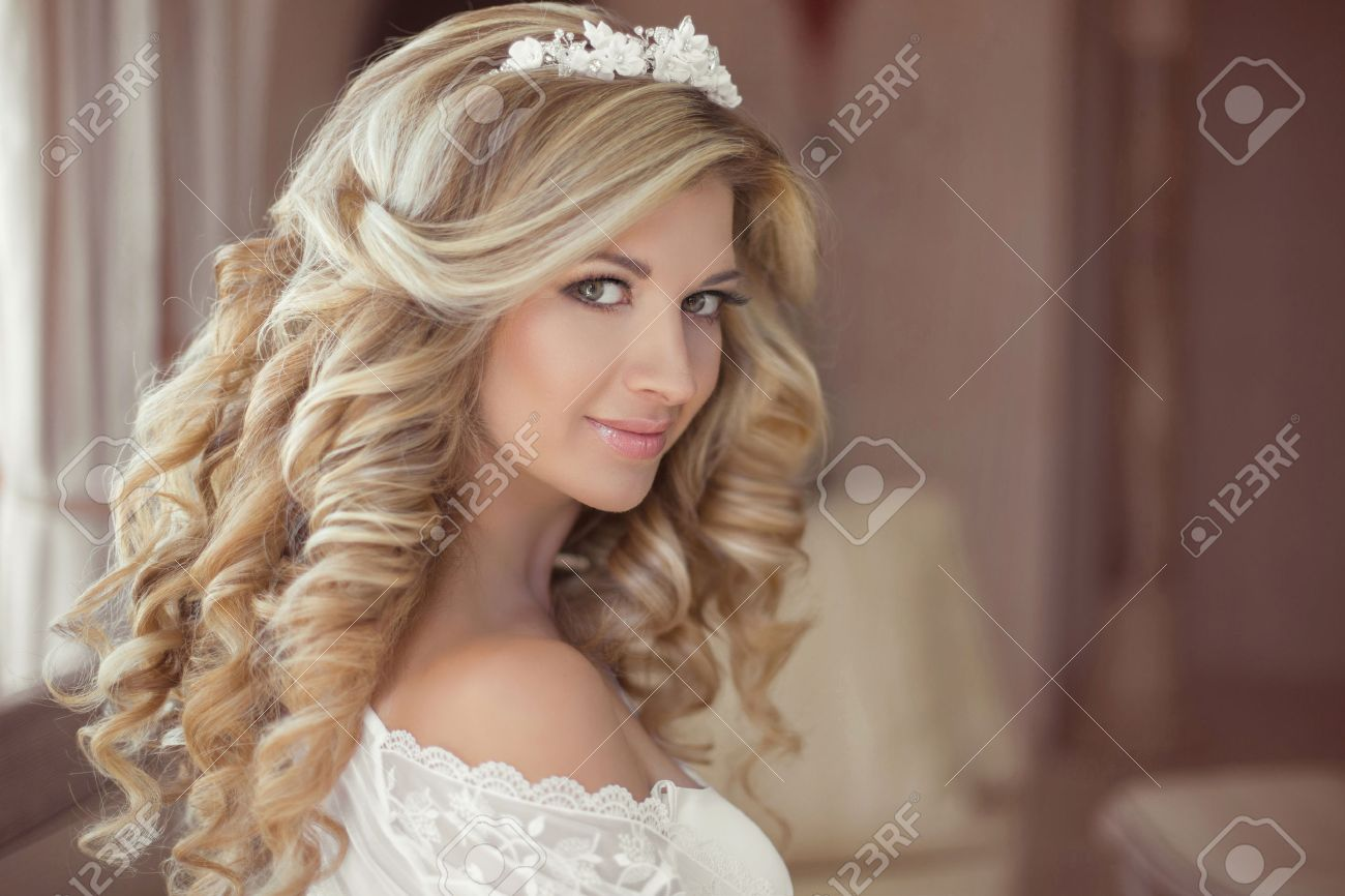 healthy hair. beautiful smiling girl bride with long blonde curly
