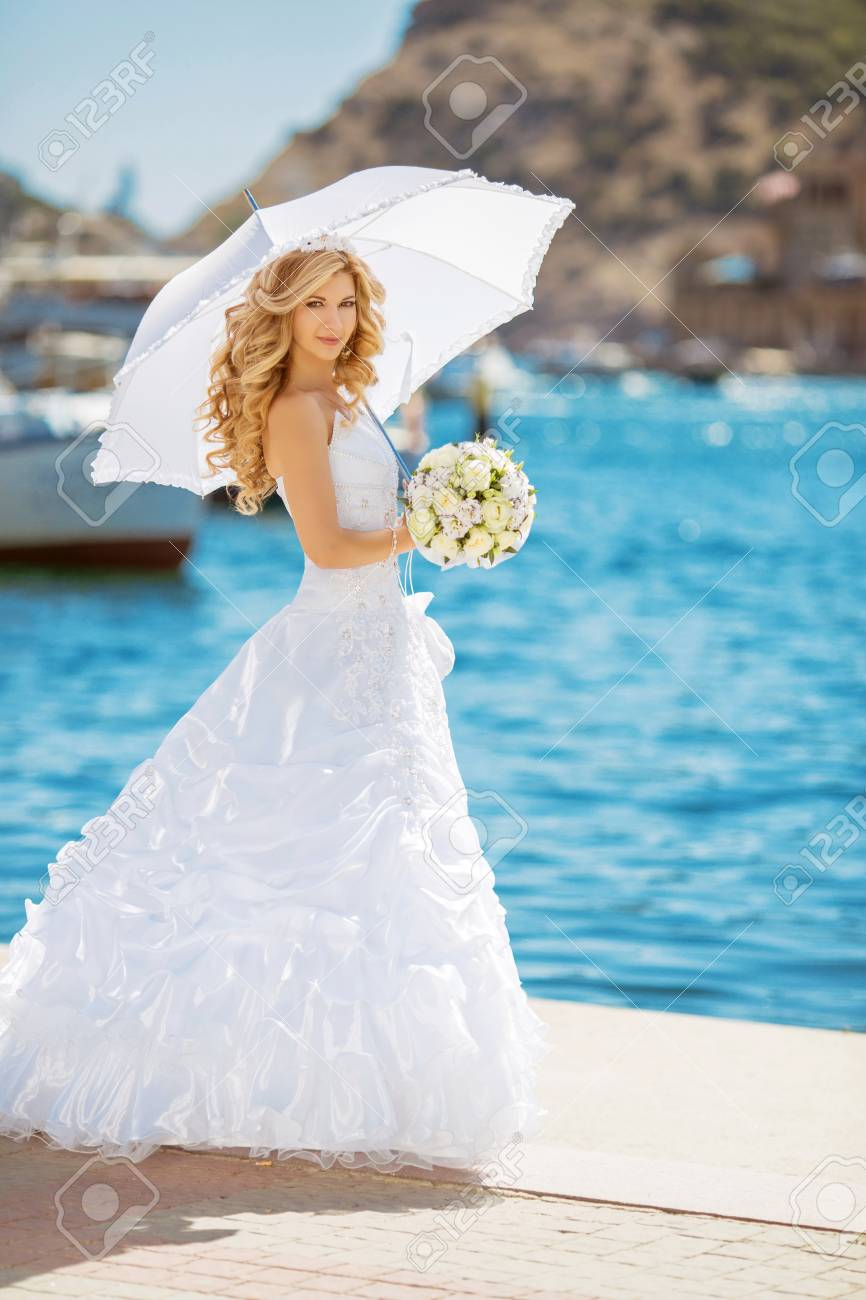 Beautiful Bride In Wedding Dress With White Umbrella, Outdoors ...