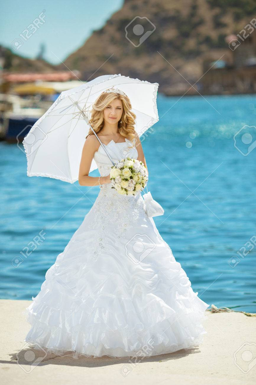 Beautiful Smiling Bride Girl In Wedding Dress With White Umbrella ...