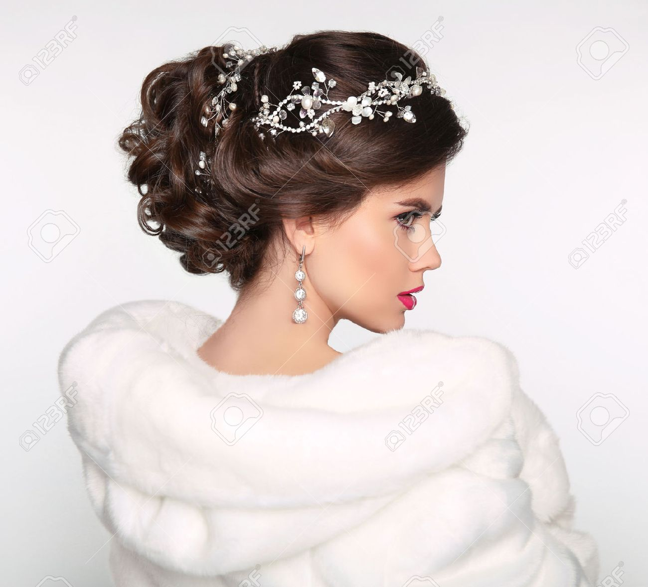 Elegant Brunette Woman In White Fur Coat. Wedding Hairstyle... Stock ...