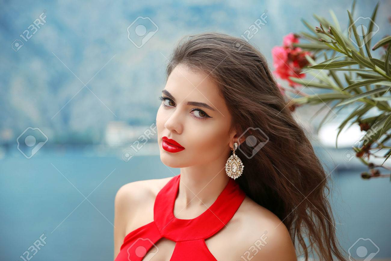 Beautiful Girl With Red Lips Long Wavy Hair And Fashion Earrings