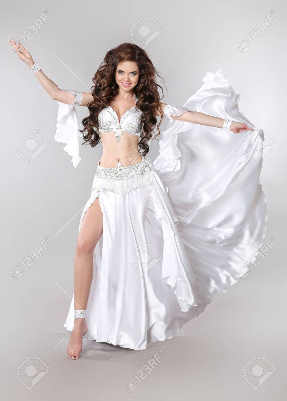 4bb768cc04e85 Belly dance. Bellydancer. Beautiful brunette Gorgeous Arabian Woman dancer  with long curly hair posing