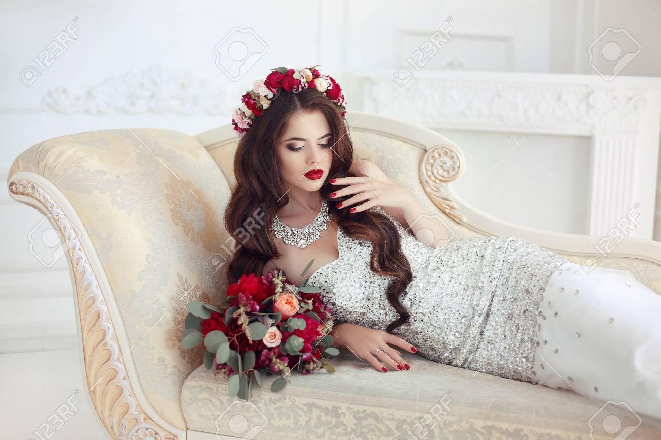Beautiful Brunette Bride Lying On Classic Elegant Sofa, Baroque ...