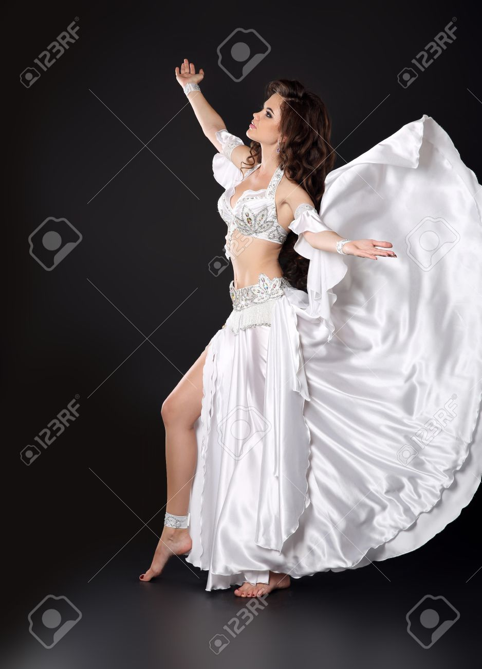 Beautiful Arabian Bellydancer Sexy Woman In Bellydance White Costume Over Black Studio Background Sensual Arabic