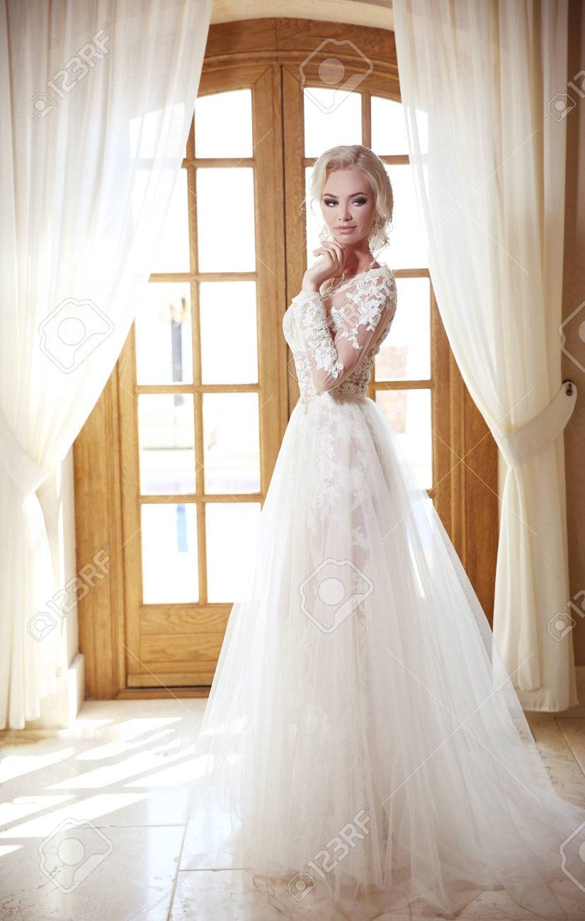 Elegant Bride In Fashion Wedding Dress. Blond Woman Model In.. Stock ...