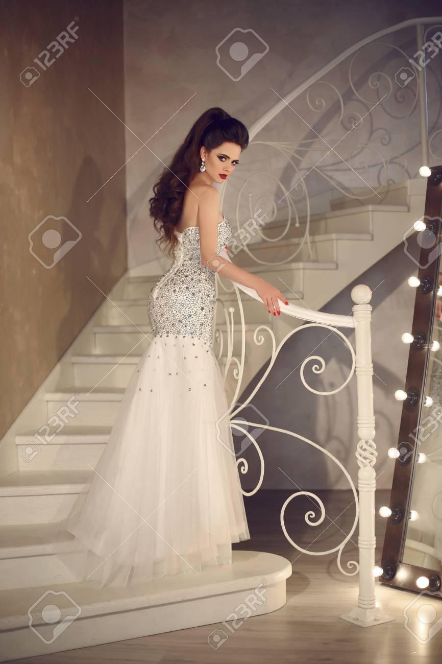 Beautiful Bride In Wedding Dress Posing On Staircase Elegant