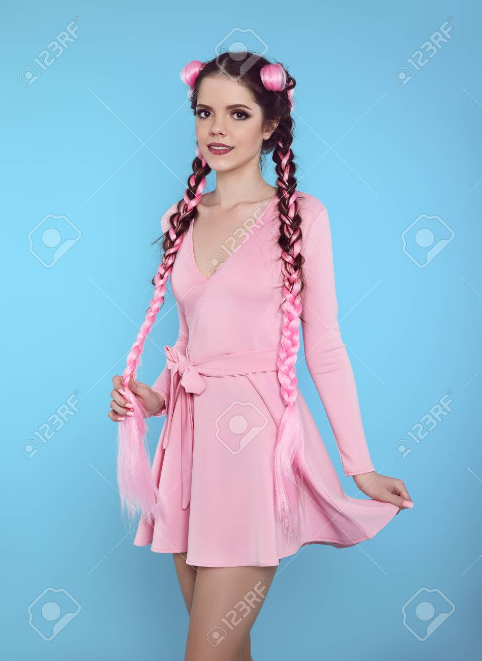 151098003ee3 ... dress isolated on blue studio background. Pretty teen girl with two  french braids from pink kanekalon