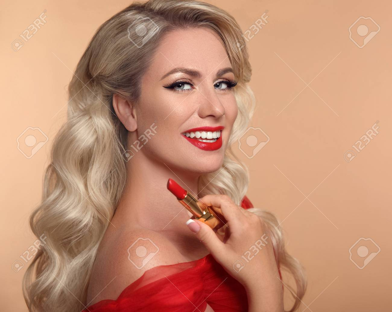 Beauty makeup. Red lips and smile. Fashion glamour portrait of pretty blonde woman with