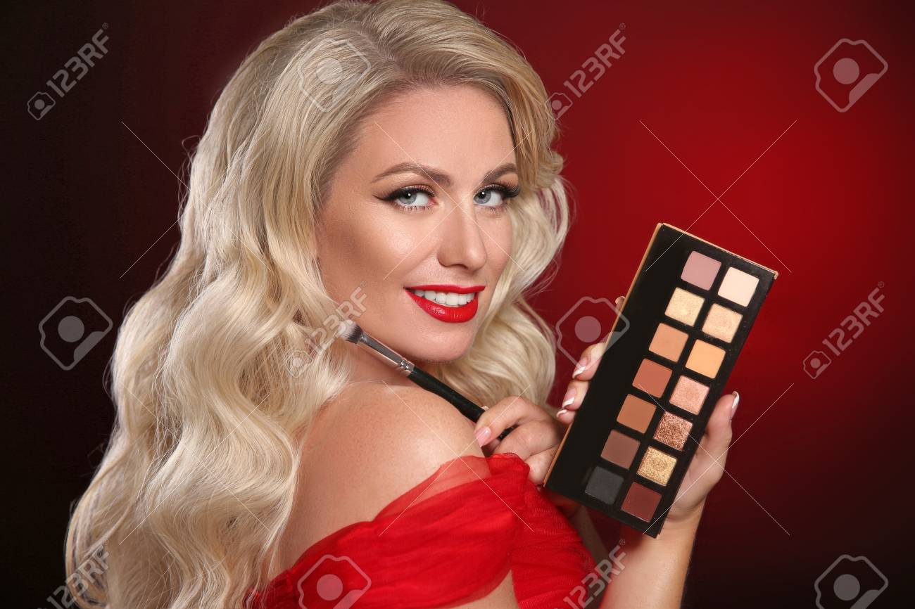 Beauty makeup. Red lips, Palette of cosmetic eye shadow. Fashion glamour portrait of