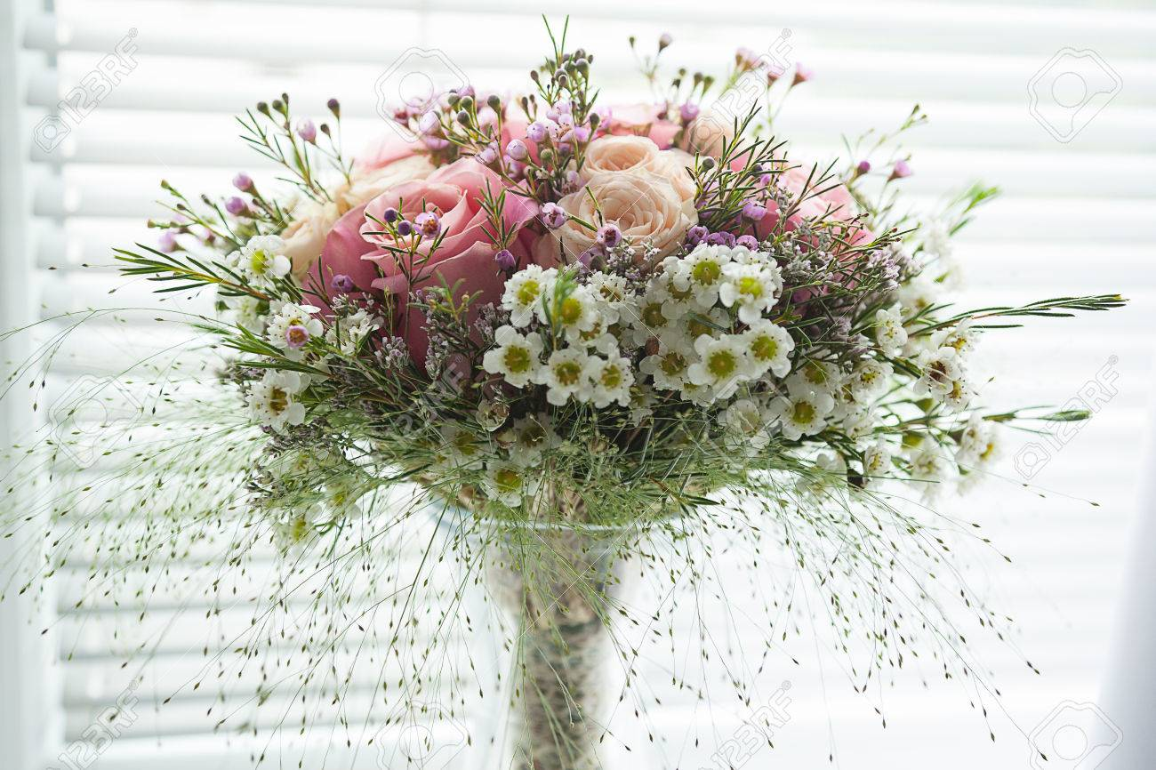 Small Pink Rustical Flower Bouquet Made Of Roses And Field Flowers