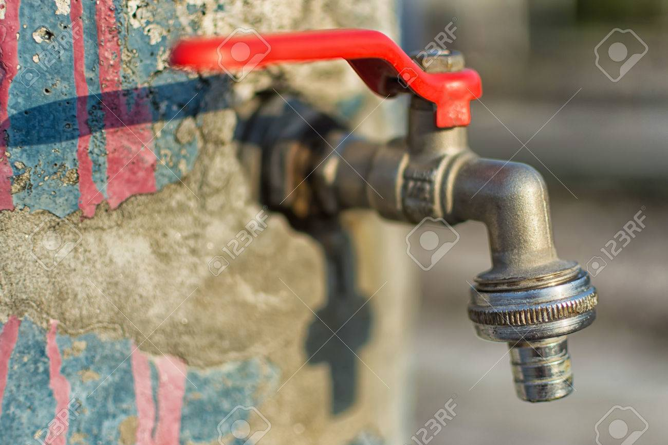 Faucet On Old Cracked Blue Painted Wall Red Handle Water Tap