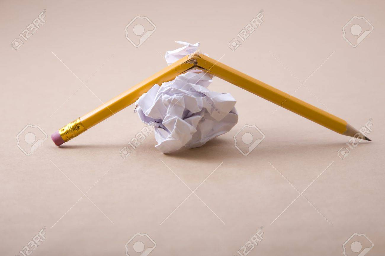 crumpled paper and crushed yellow pencil Stock Photo - 6675025
