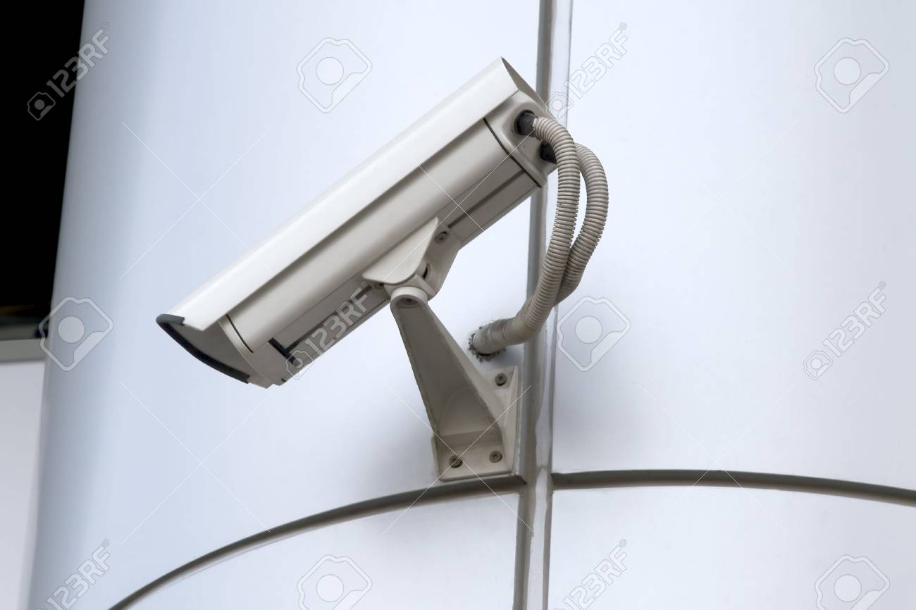 detail of surveillance camera mounted on metal facade Stock Photo - 7670668