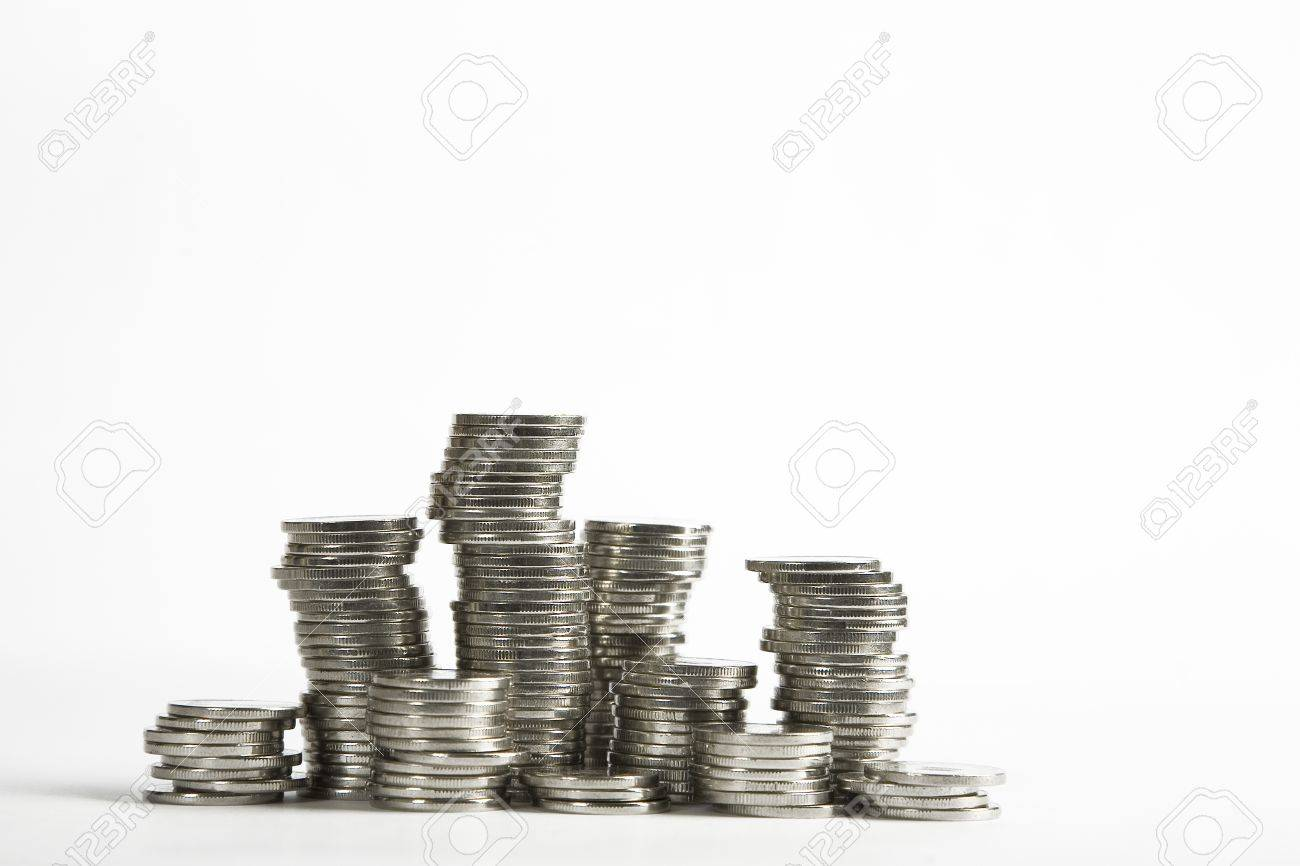 Stacks of silver coins on white background Stock Photo - 8288554
