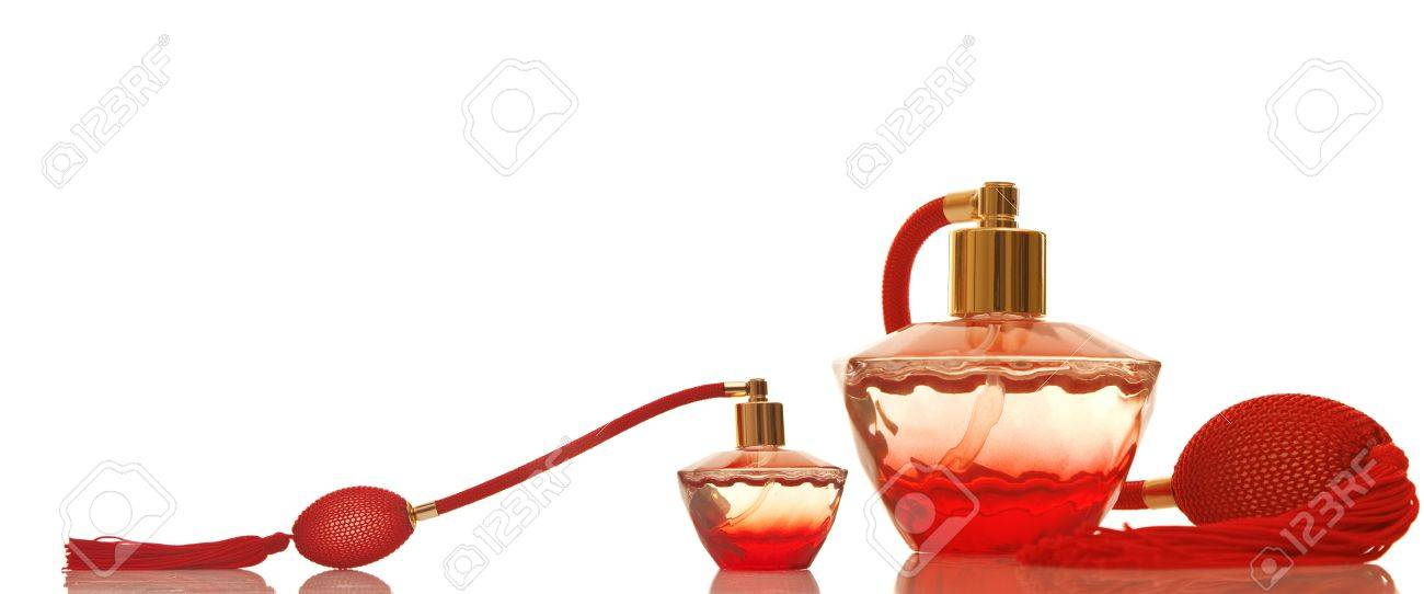 perfume in a red glass bottles on white background stock photo
