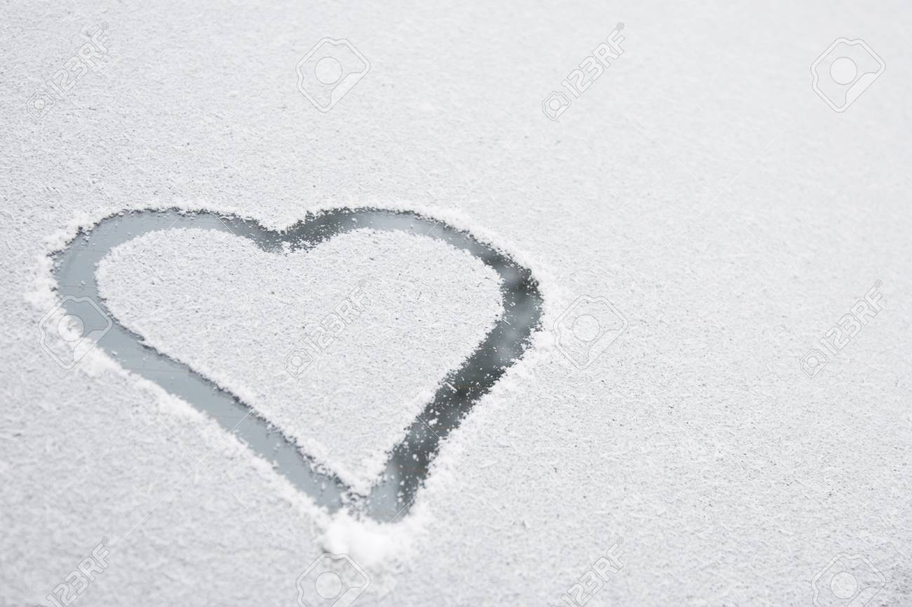 Heart shape drawn on white snow, love symbol for Valentine Day Stock Photo - 9724995