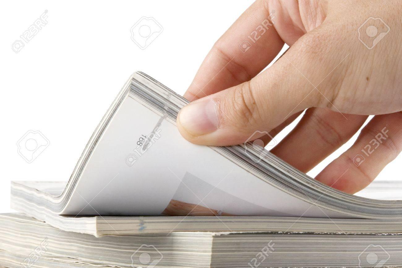 man hand browsing through stack of magazines Stock Photo - 9965861