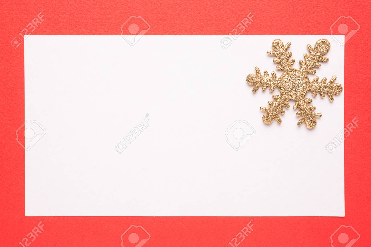 blank christmas card or invitation with snowflake on red background