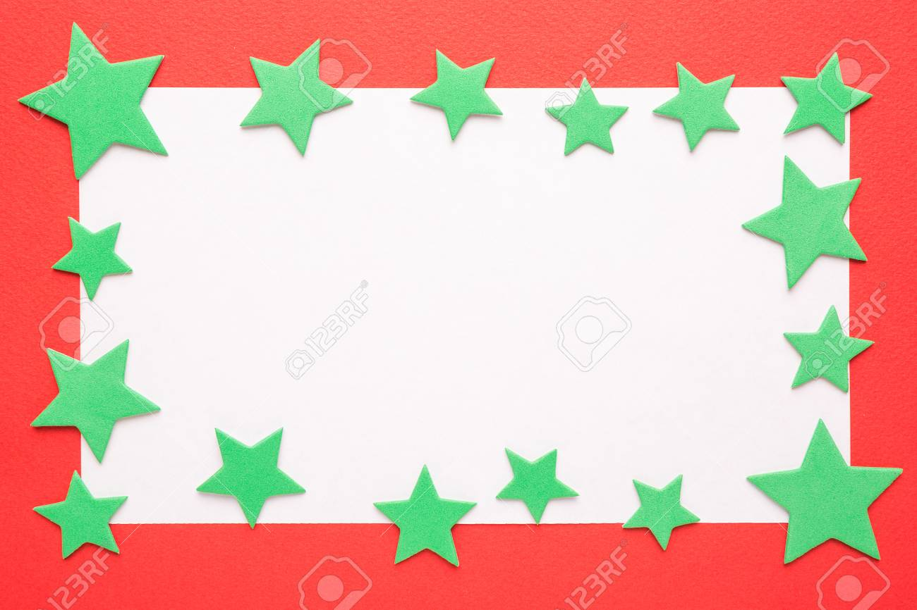 blank christmas card or invitation with green stars on red