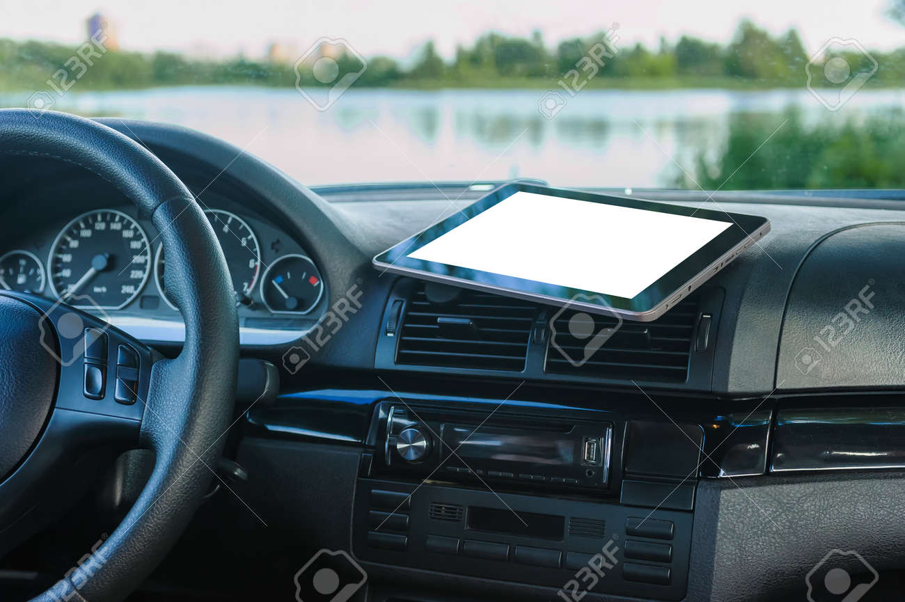 Tablet mockup, on the car dashboard. Against the background of a river, lake, a concept on the theme of tourism - 158518271