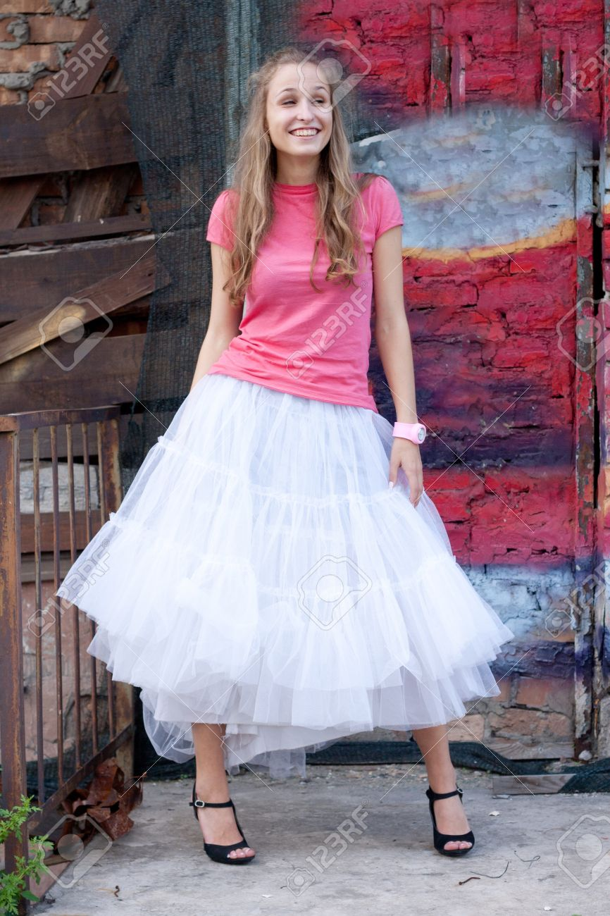 Girl In White Skirt And Pink T Shirt In The City Stock Photo