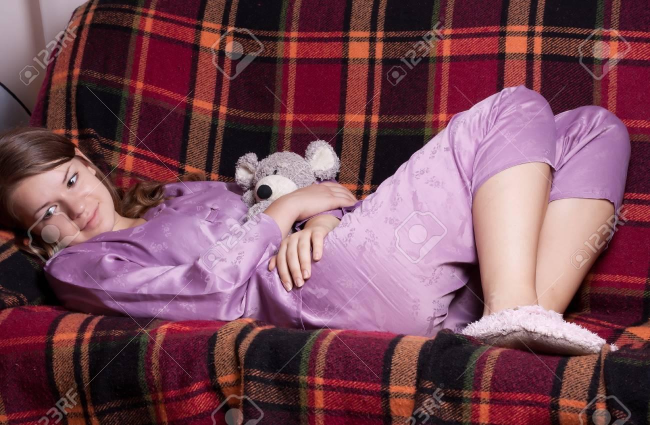 The girl in purple pajamas in the room Standard-Bild - 11134267