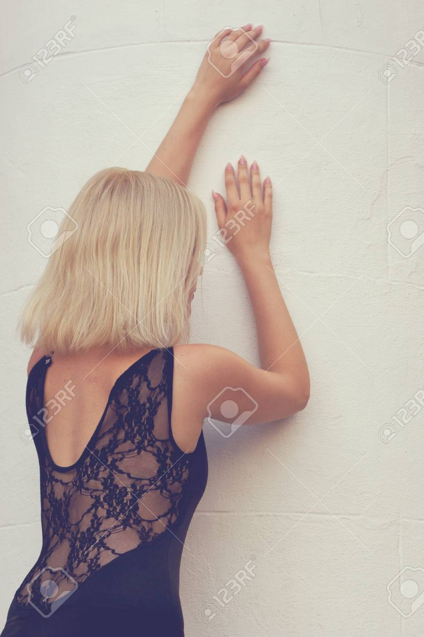 Beautiful refined girl back against the wall Stock Photo - 15044162