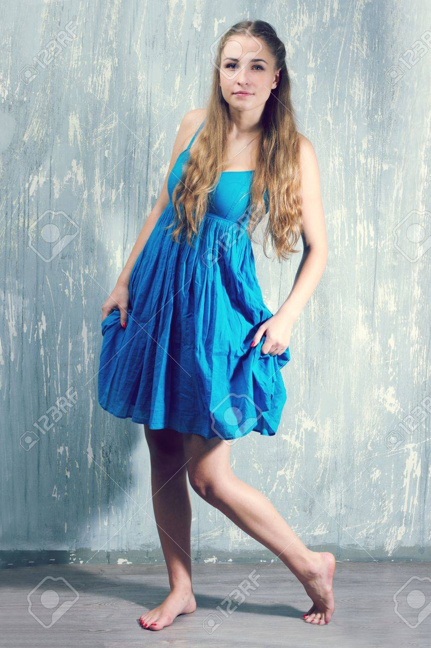 young blonde woman in blue dress  studio shoot Stock Photo - 15646959