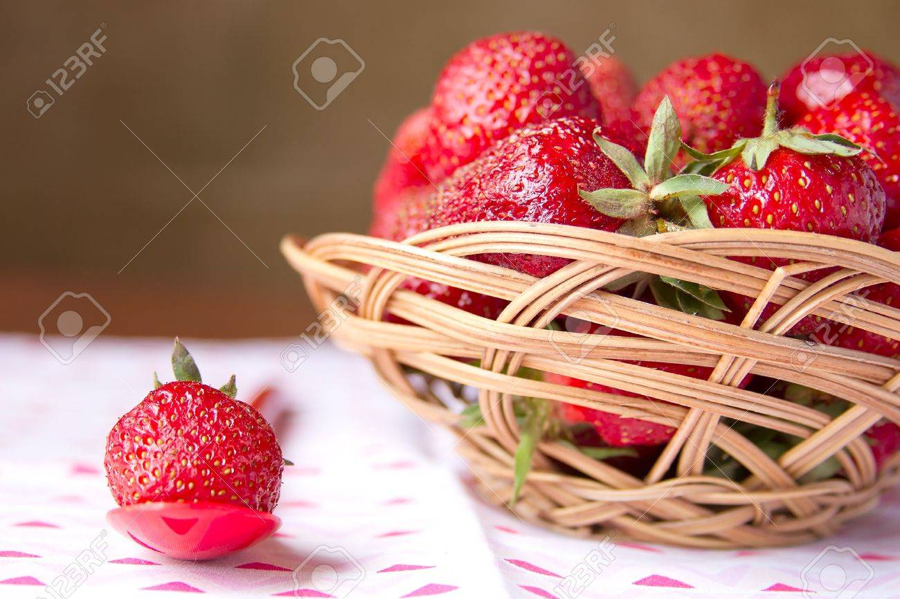 Fresh strawberries in a basket on a round table Stock Photo - 16213698