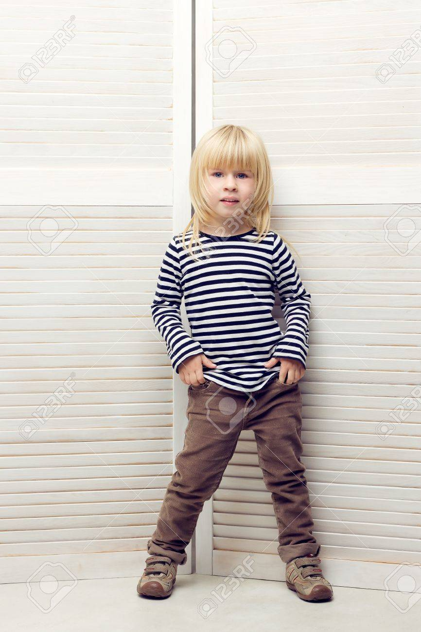 Blonde girl 3 years old dressed as a boy Stock Photo - 16466594