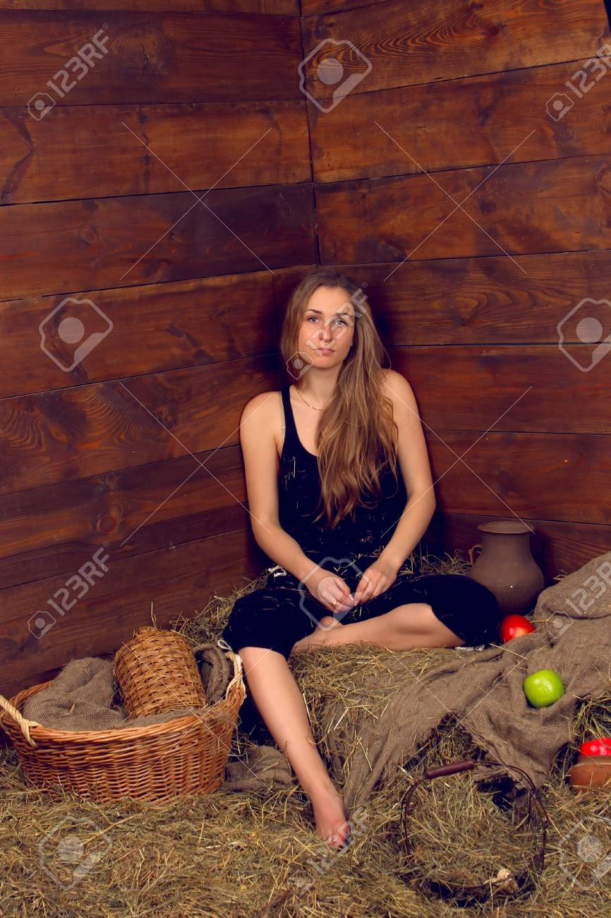 beautiful smiling woman with many apple in basket on haystack at farm Stock Photo - 18064121