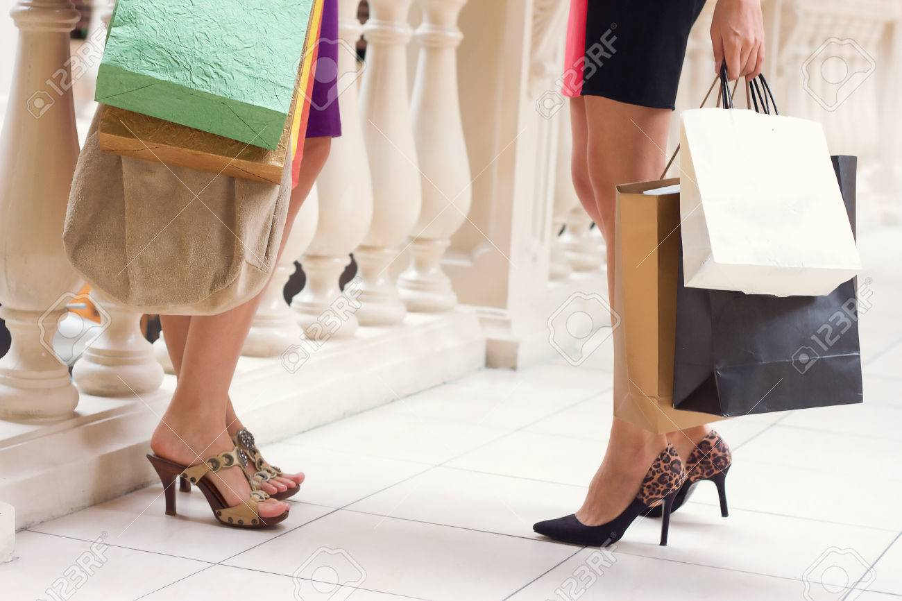 Beautiful girls with shopping bags walking in the store Stock Photo - 22879785