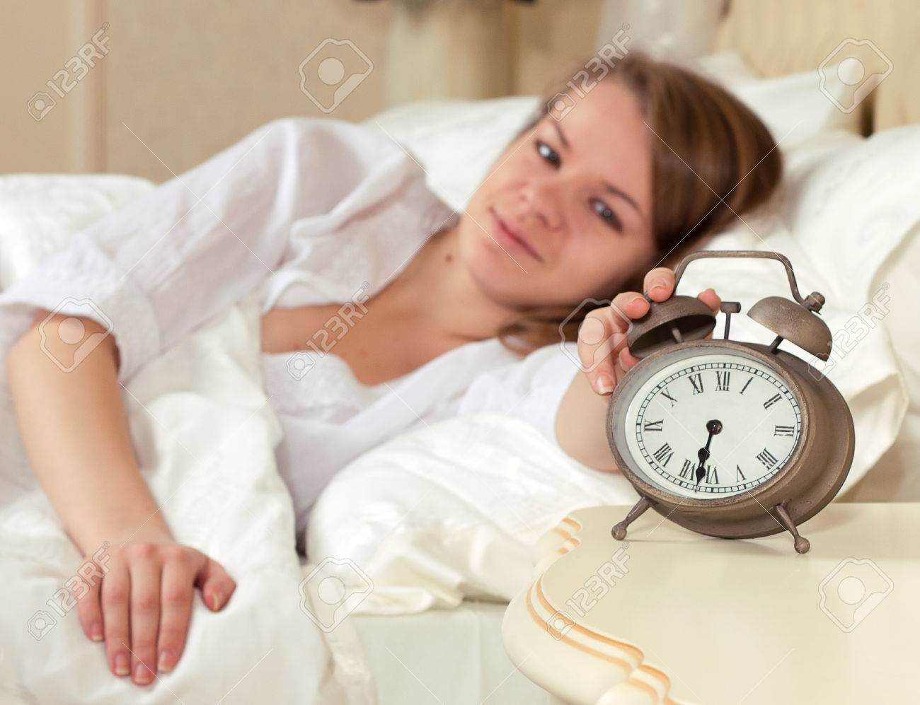 Woman's hand off the alarm clock, 6.30 am Stock Photo - 24000978