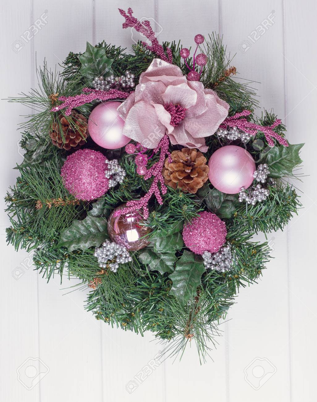 Christmas Wreath On A Rustic White Wooden Front Door Stock Photo