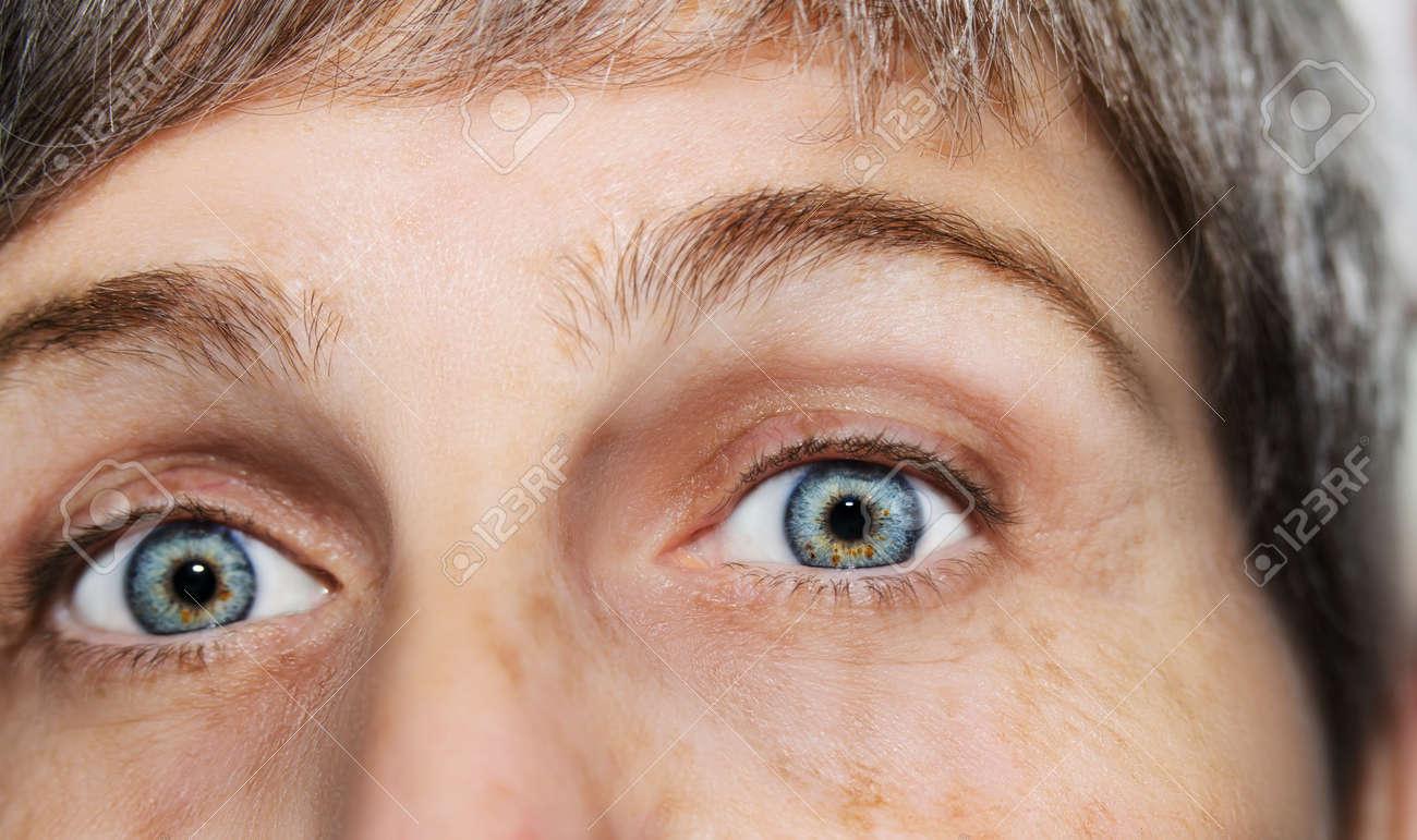 A beautiful insightful look eye. Close up shot. The eye of an elderly woman. - 139340945