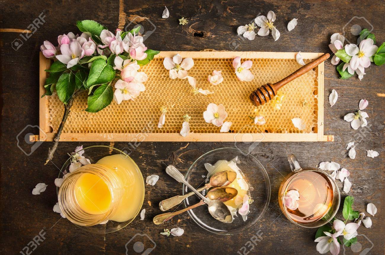 Honeycomb With Wooden Dipper And Fresh Blossom With Honey Jar And ...