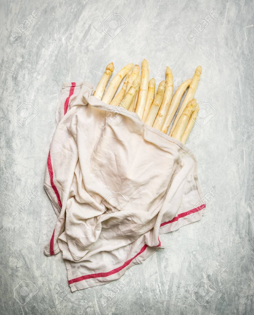 White Asparagus Under Wet Towel On Rustic Wooden Background Top