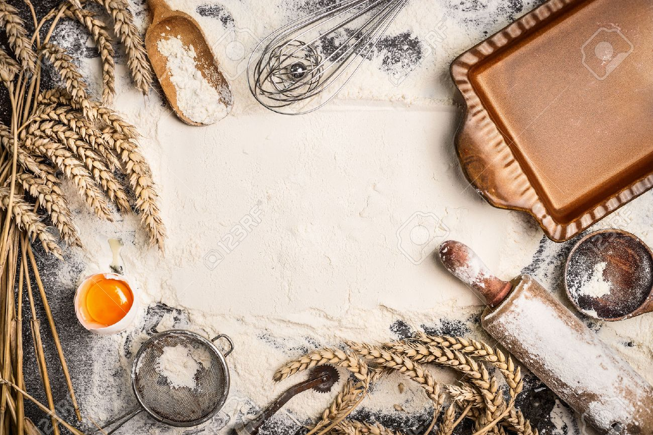 flour baking background with raw egg, rolling pin, wheat ear and rustic bake pan. Top view - 43275219