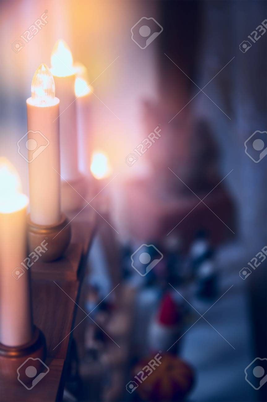 Electric Christmas Candles.Electric Christmas Candles And Decoration Over Room Background