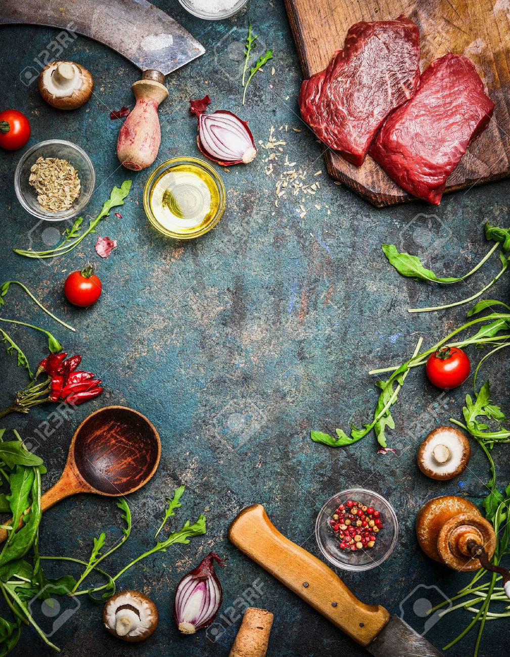 Fresh Beef Steak, Wooden Spoon, Knife And Aromatic Herbs, Spices ...