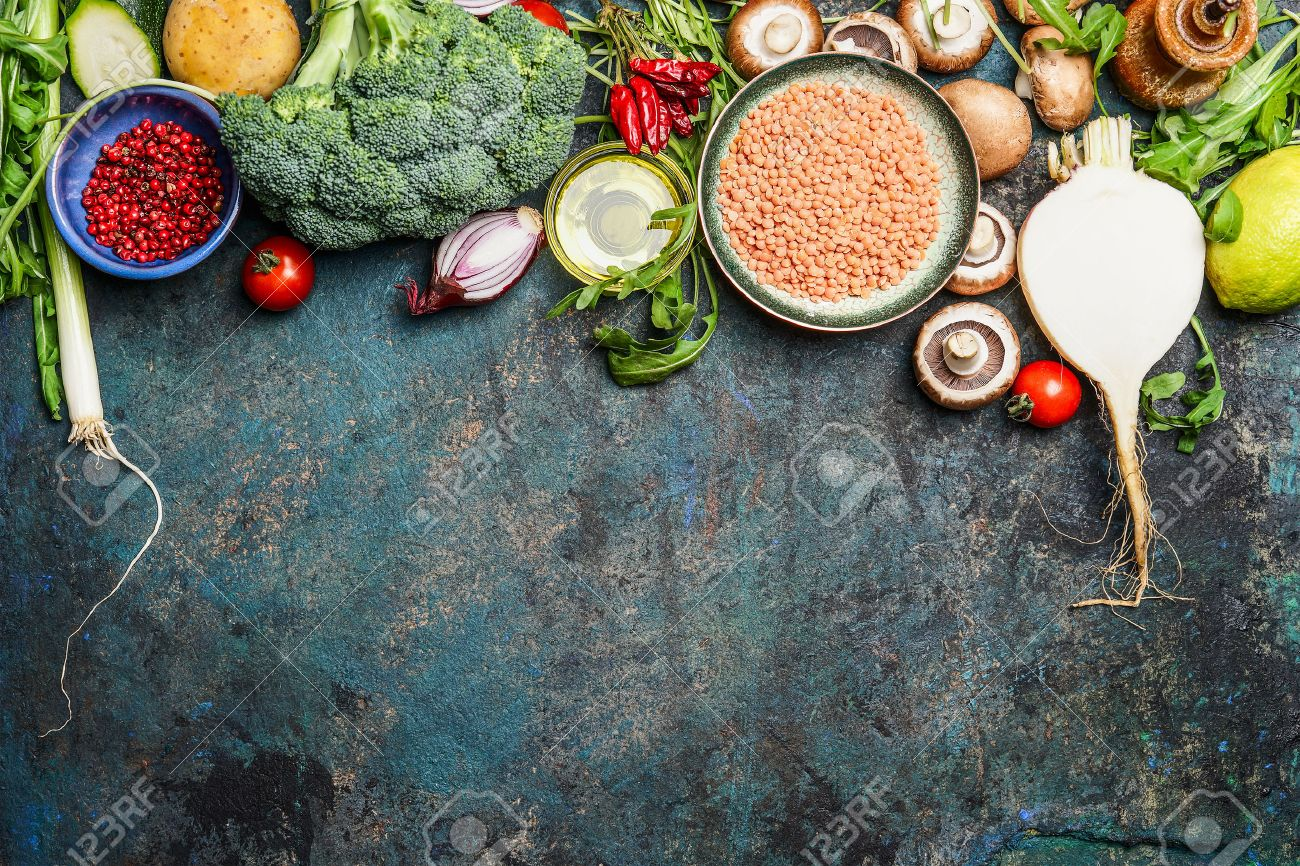 variety of vegetables, red lentil and ingredients for healthy cooking on rustic background, top view, horizontal border. Vegan food or diet eating concept. Stock Photo - 48677493