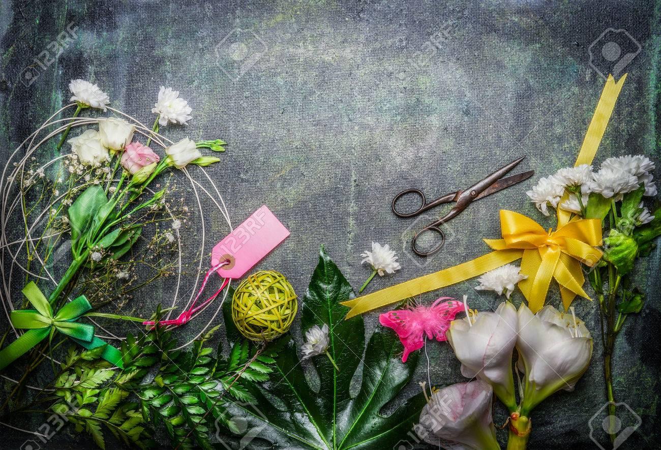 Beautiful fresh flowers pair of scissors and tools to create beautiful fresh flowers pair of scissors and tools to create bouquet on rustic background izmirmasajfo