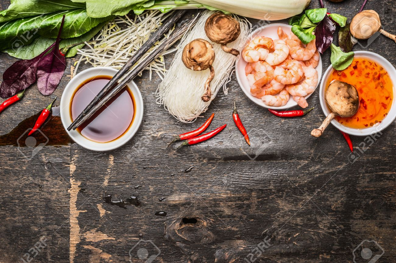 Asian cooking ingredients with soy and sweet sour sauce and asian cooking ingredients with soy and sweet sour sauce and chopsticks on rustic background forumfinder Image collections