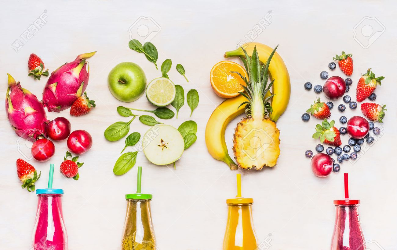 Bottles of Fruits smoothies with various ingredients on white wooden background, top view. Superfoods and healthy lifestyle or detox diet food concept. - 52237395