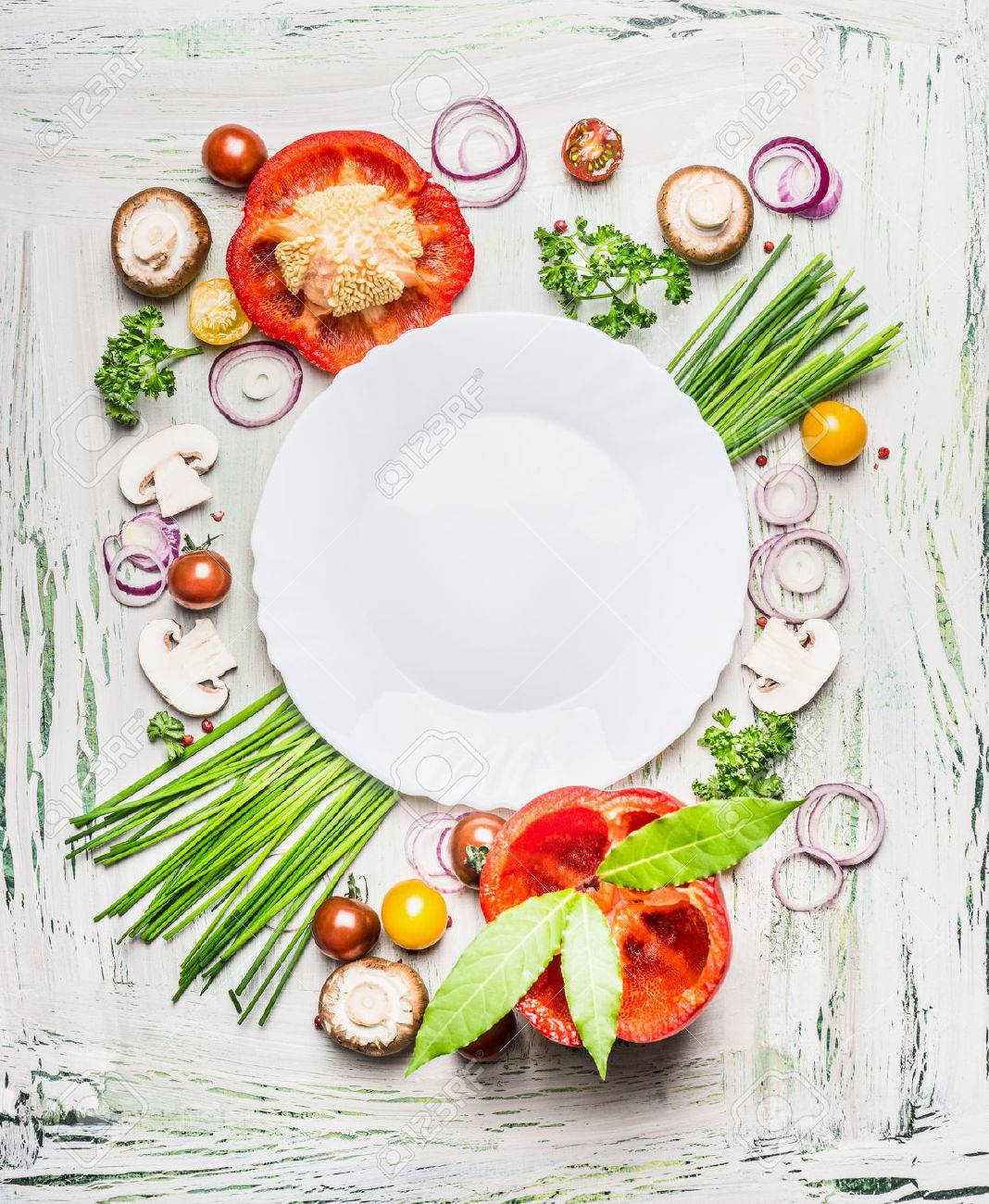 Various vegetables and seasoning cooking ingredients around blank plate on light rustic wooden background, top view composing. Healthy eating and diet food concept. - 54220508