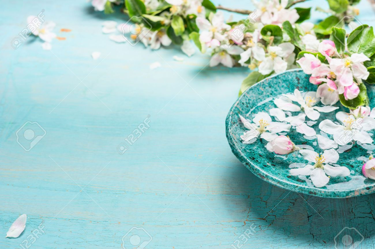 Aroma Bowl With Water And White Blossom Flowers On Turquoise Stock