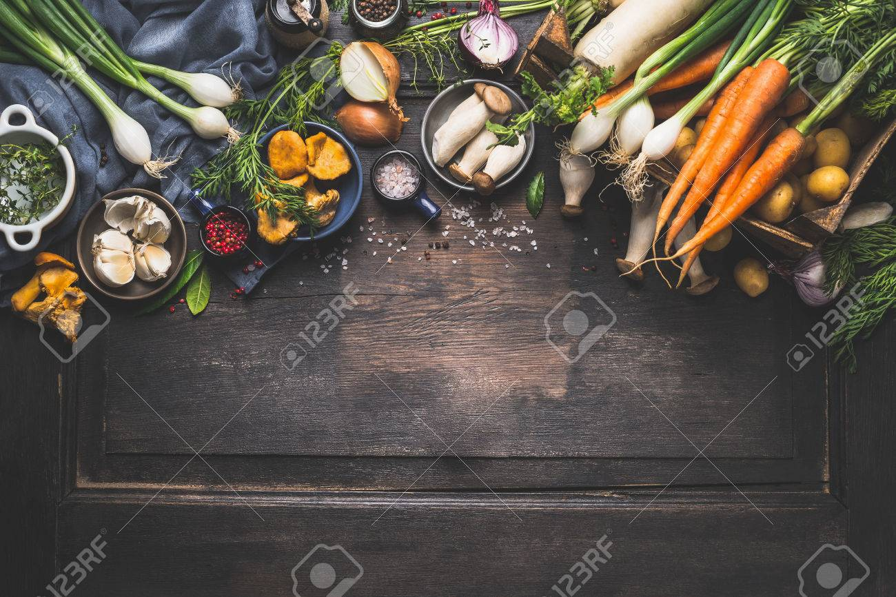 Organic harvest Vegetables from garden and forest mushrooms. Vegetarian ingredients for cooking on dark rustic wooden background, top view, border - 59606801