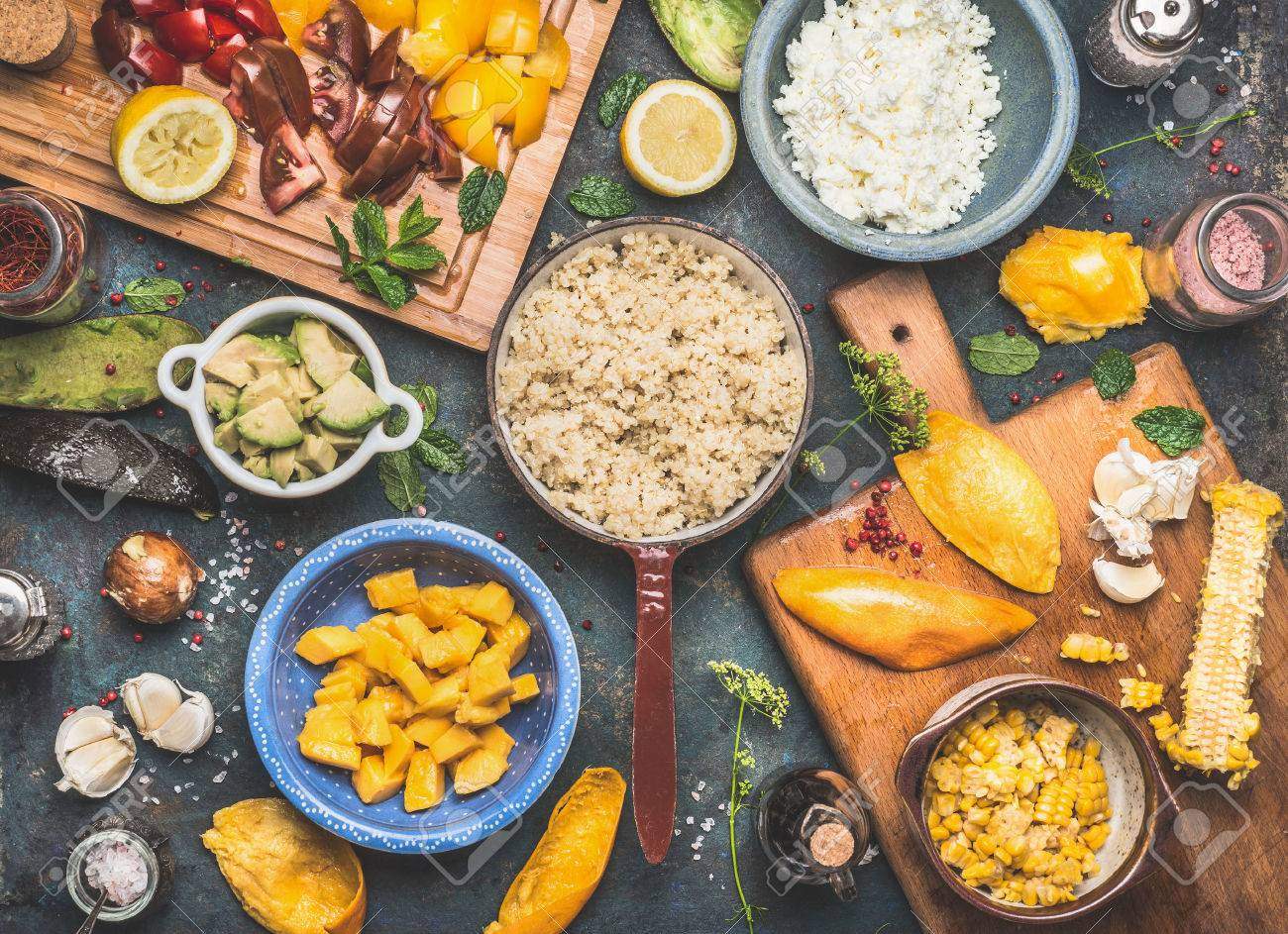 Quinoa salad preparation with vegetables and fruits cooking ingredients on dark rustic background, top view. Superfood, healthy Eating or vegan food concept - 59607337