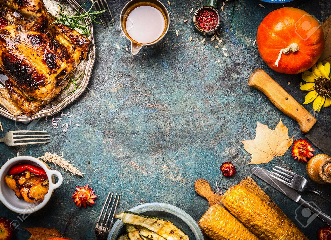 Roasted whole chicken or turkey with sauce and grilled autumn vegetables: corn,pumpkin ,paprika on dark rustic background, top view, frame. Thanksgiving Day food concept - 61354525